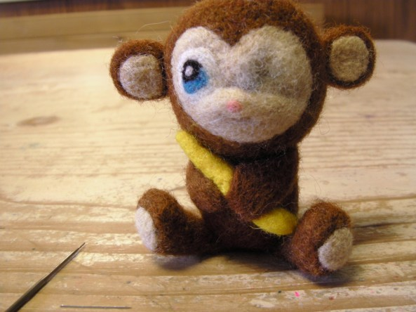 Needle Felted Monkey Toy Being Repaired