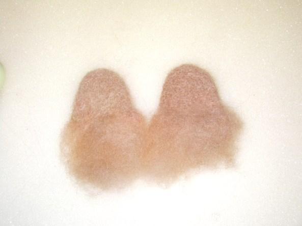 a pair of needle felt ears