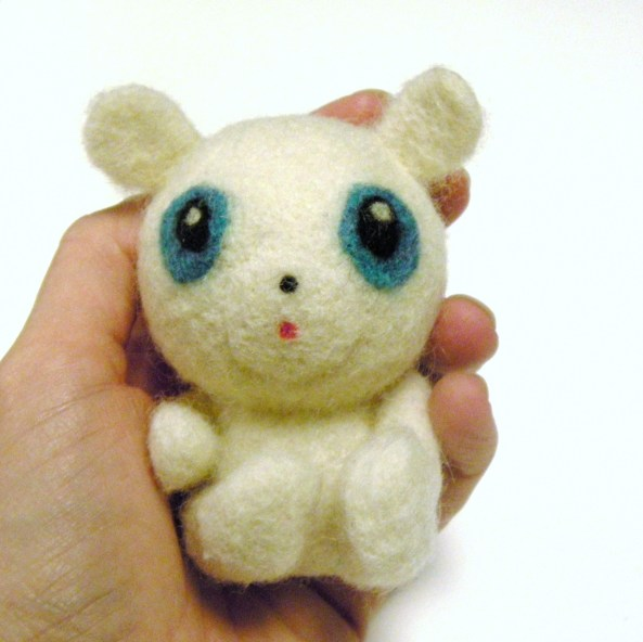 a repaired needle felt toy