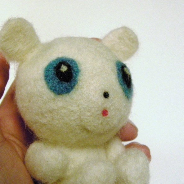 repairing a felted figurine