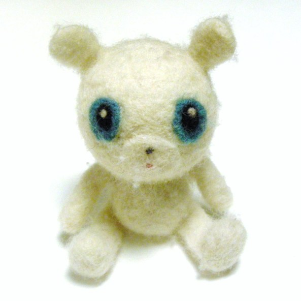 a worn out and played wiht felted bear