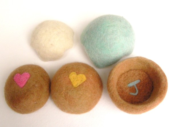 wet and needle felted eggs and nests toys