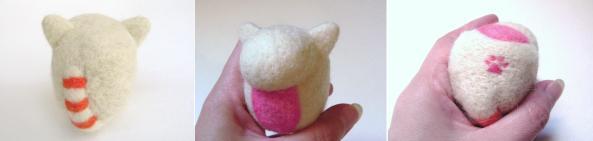 adding detail work on a needle felt cat