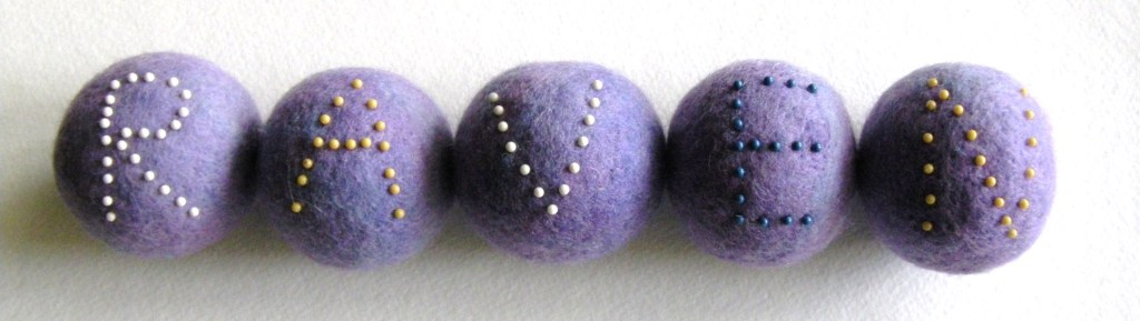 tutorial on making felted balls with a name spelled out