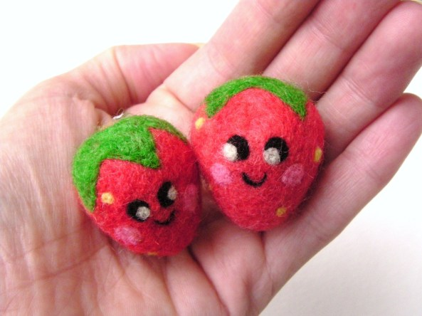 strawberry with a face needle felted