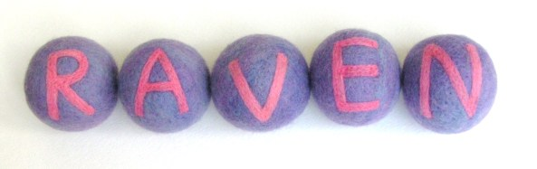 wet and needle felted balls with letters