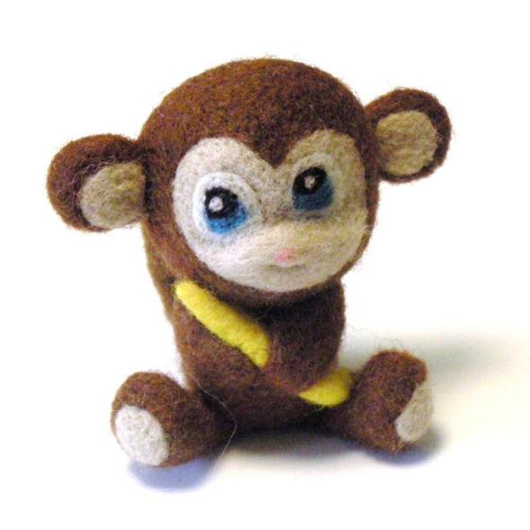 needle felted monkey holding a banana