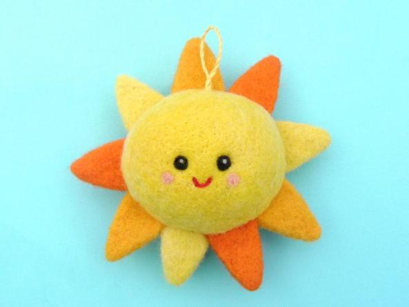 Felted Smiling sun for nursery decoration
