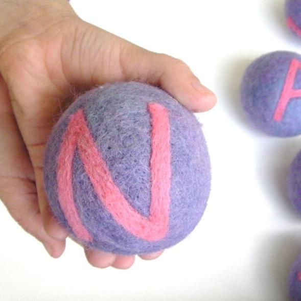 felted balls with letters to spell out a child's name